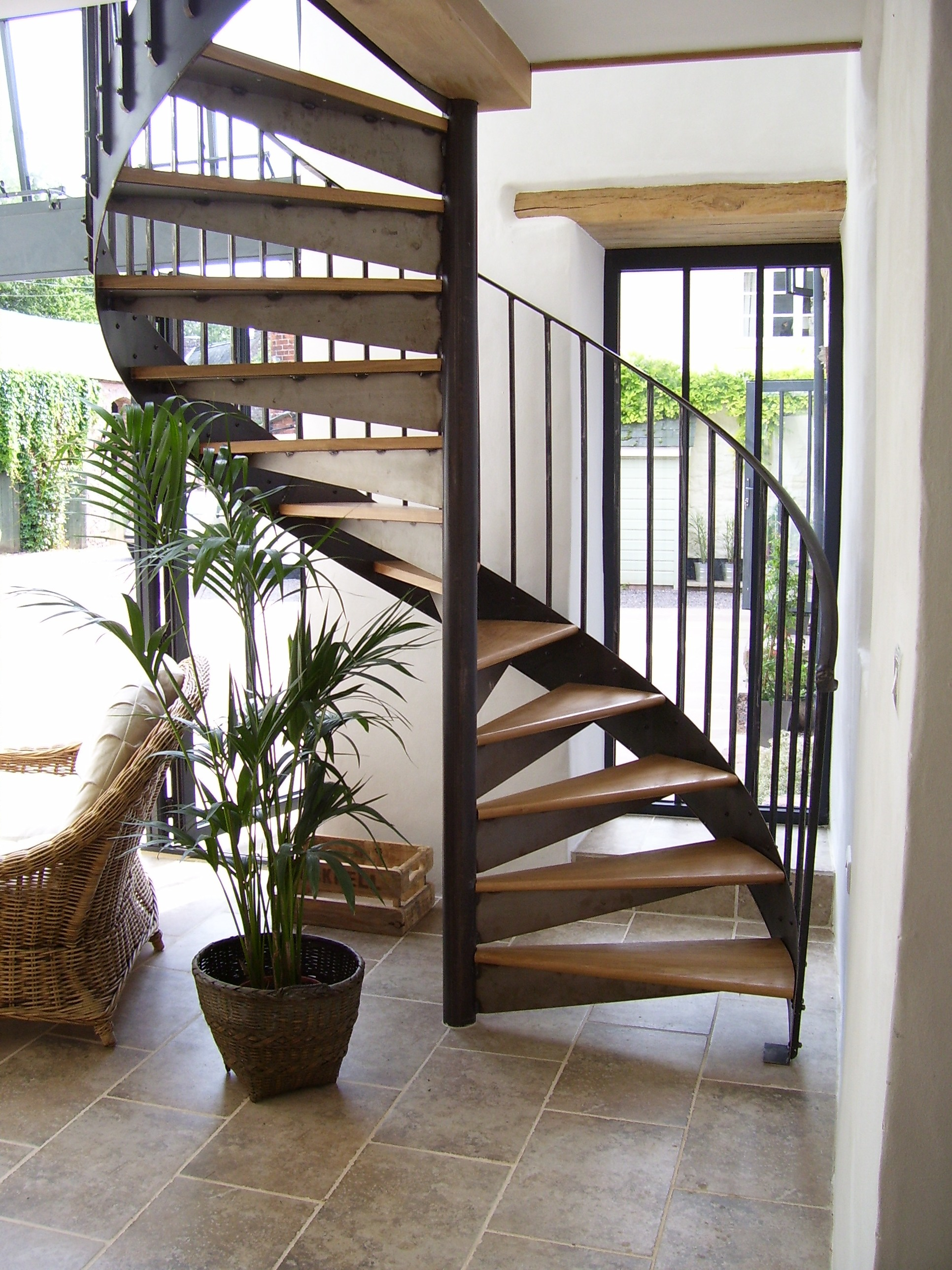 Wrought iron staircase spiral staircases and balustrades for Spiral stair design