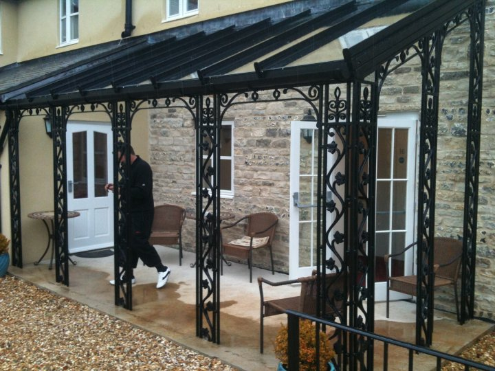 wrought iron verandas and porches. Black Bedroom Furniture Sets. Home Design Ideas